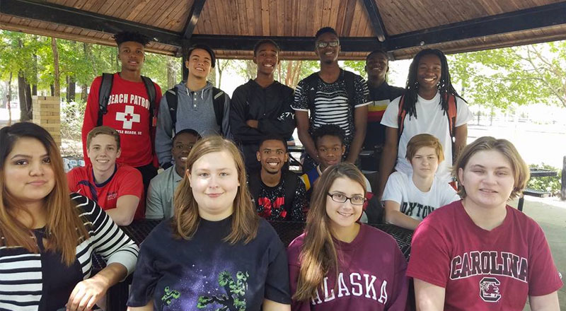 Students in a shelter at a park
